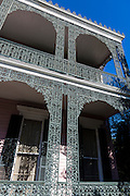 Grand mansion house, ornate lacy wrought iron balcony and double gallery in the Garden District, New Orleans, Louisiana, USA