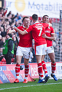 Cauley Woodrow of Barnsley (9) scores a goal and celebrates with Jacob Brown of Barnsley (33) and Ryan Hedges of Barnsley (7) to make the score 2-0 during the EFL Sky Bet League 1 match between Barnsley and Wycombe Wanderers at Oakwell, Barnsley, England on 16 February 2019.