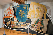 """In Appenzell Museum, these flags are 1640-1663 replicas (by painter Hans Bildstein) of flags captured from the 1403-1407 Appenzell Wars of Liberation through the wars against the Turks around 1600, which were kept in the parish church until 1822 as offerings to God and St. Mauritius. Appenzell Museum, which is in the town hall, shows a cross section of the Swiss Canton's history and culture. Appenzell village is in Appenzell Innerrhoden, Switzerland's most traditional and smallest-population canton (second smallest by area). The canton of Appenzell divided itself into an """"inner"""" and """"outer"""" half (Rhoden) as a consequence of the Reformation in Switzerland in 1597: Appenzell Innerrhoden (Catholic) and Appenzell Ausserrhoden (Protestant)."""