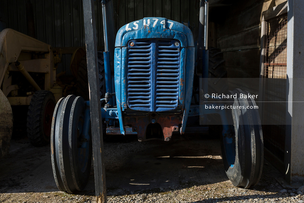 A Massey Ferguson tractor on a rural smallholding on 22nd April 2017, in Wrington, North Somerset, England.