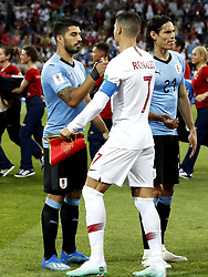 (l-r) Luis Suarez of Uruguay, Cristiano Ronaldo of Portugal, Edinson Cavani of Uruguay during the 2018 FIFA World Cup Russia round of 16 match between Uruguay and at the Fisht Stadium on June 30, 2018 in Sochi, Russia