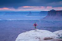 Young man hiking in Canyonlands NP near Moab, Utah.