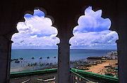 Ilha de Mozambique fishing harbour seen through the windows of the Great Mosque minaret.