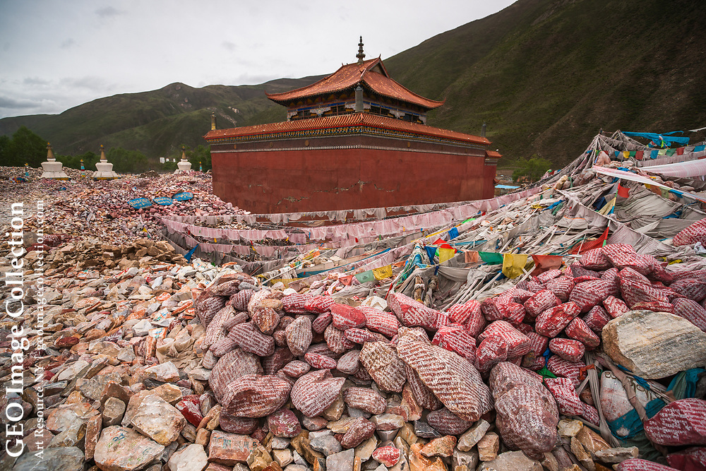 A growing mountain of more than a billion mani stones at Gyanamani Temple, in Yushu, an area rocked by earthquakes in 2010. This collection of hand-carved stones with Buddhist sutras and symbols is the largest in the world. Qinghai, China