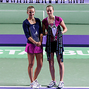 Petra Kvitova (R) of Czech Republic holds up the trophy after she won the final match against Victoria Azarenka (L) of Belarus at the WTA Championships tennis tournament in Istanbul, Turkey on 30 October 2011. Photo by TURKPIX