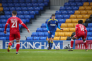 AFC Wimbledon defender Steve Seddon (42) dribbling and being tracked by ex AFC Wimbledon player Crawley Town midfielder Dannie Bulman (21) during the The FA Cup match between AFC Wimbledon and Crawley Town at Plough Lane, London, United Kingdom on 29 November 2020.