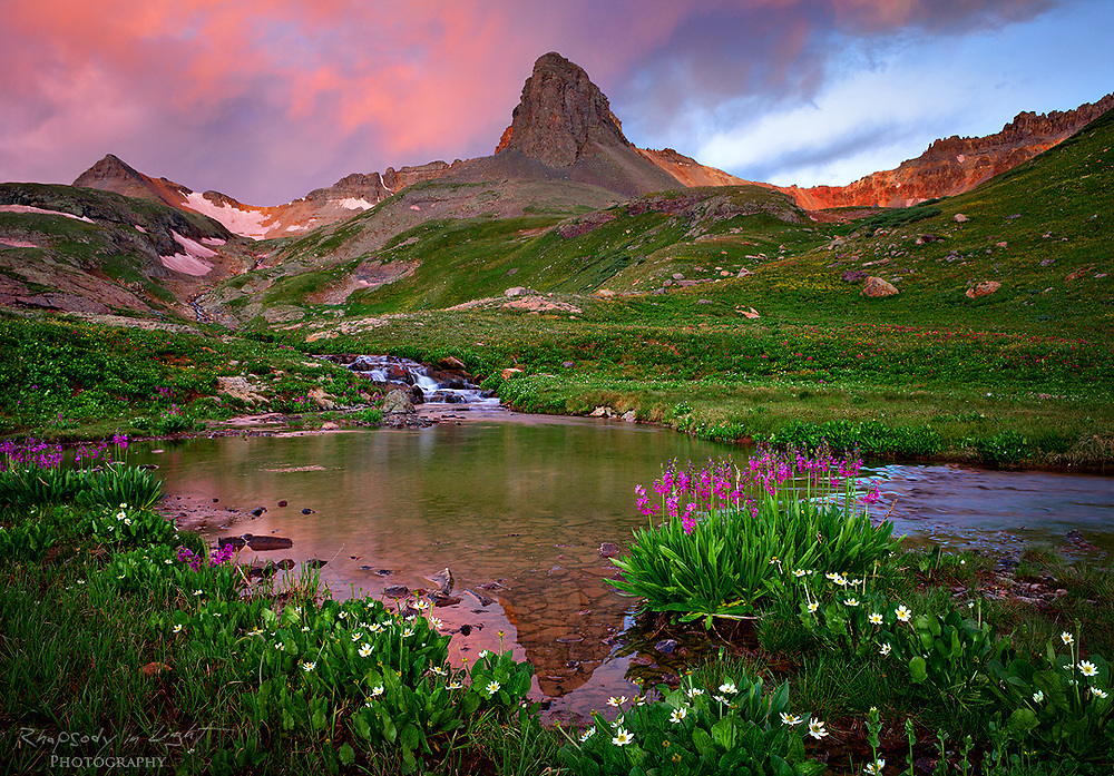 Sunrise sets the clouds ablaze above Ice Lakes Basin in Southwest Colorado.