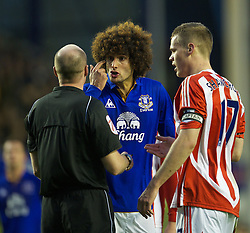 04122011, Goodison Park, Liverpool, ENG, Premier League, FC Everton vs Stoke City, 14 Spieltag, im Bild Everton's Marouane Fellaini argues with referee Lee Mason against Stoke City during the football match of english Premier League, 14th round between FC Everton and Stoke City at Goodison Park, Liverpool, ENG on 2011/12/04. EXPA Pictures © 2011, PhotoCredit: EXPA/ Sportida/ David Rawcliff..***** ATTENTION - OUT OF ENG, GBR, UK *****
