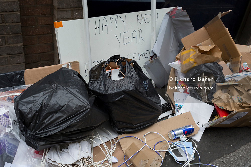 Illegally dumped New Tear rubbish in a side-street off Oxford Street in the West End, on 16th January 2019, in London, England.