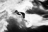 Surfers on the Eisbach River, Munich Germany. September 2006<br /> Photograph Richard Robinson © 2006.