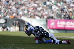 Detroit Lions wide receiver Nate Burleson (13) is tackled by Philadelphia Eagles middle linebacker DeMeco Ryans (59) during the NFL game between the Detroit Lions and the Philadelphia Eagles on Sunday, October 14th 2012 in Philadelphia. The Lions won 26-23 in Overtime. (Photo by Brian Garfinkel)