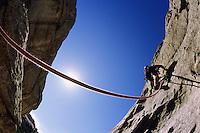 A young man rock climbing at the City of Rocks National Reserve, Idaho.