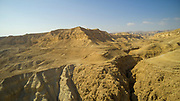 Aerial Photography with a drone. Elevated view of the eroded sandstone mountains on the shore of the Dead Sea, Israel.