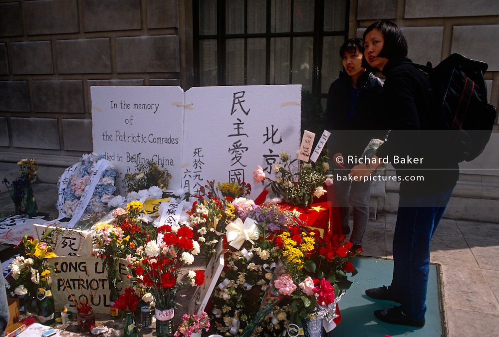 Members of Chinese exile community keep vigil and await more news outside their embassy a day after the Tiananmen Sq massacre. A mock coffin draped in the Chinese flag sit on the London pavement, a presence to officials in the embassy opposite. The political crackdown that initiated on June 3–4 1989 became known as the Tiananmen Square Massacre as troops with assault rifles and tanks inflicted casualties on unarmed civilians trying to block the military's advance towards Tiananmen Square in the heart of Beijing, which student demonstrators had occupied for seven weeks.