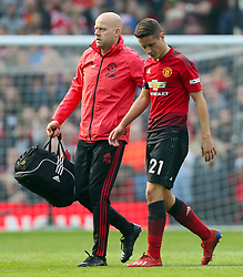 Manchester United's Ander Herrera leaves the pitch with medical staff
