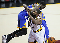 The Golden State Warriors' Draymond Green lands on the Cleveland Cavaliers' Tristan Thompson in the fourth quarter during Game 4 of the NBA Finals at Quicken Loans Arena in Cleveland on Friday, June 9, 2017. The Cavs won, 137-116, trimming their series deficit to 3-1. (Photo by Leah Klafczynski/Akron Beacon Journal/TNS) *** Please Use Credit from Credit Field ***
