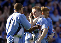 Photo. Glyn Thomas. <br /> Coventry City v Brighton and Hove Albion. <br /> Coca Cola Championship. 02/04/2005.<br /> Coventry's Gary McSheffrey (C) is congratulated by teammates after scoring from the penalty spot.