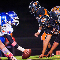 102512       Cable Hoover<br /> <br /> The Gallup Bengals defensive line square off against the Los Lunas Tigers Thursday at Public School Stadium.