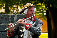 A flute player in historical costume, Sanssouci Palace, Sanssouci Park (a UNESCO World Heritage site), Potsdam, Germany