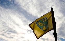 A Norwich City flag flies in the wind prior to the match