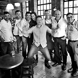 """Jamie Oliver releases a photo on Instagram with the following caption: """"Today we had a sweet lunch party for @jamiesfifteen being 15 years old at the end of #londonfoodmonth and some of our old wonderful graduates and friends came back to do a shift @timsiadatan @johnrelihan @deanmcclumpha @gennarocontaldo @dannymccubbin @elisa__roche and @santos.almir.7 big love guys what a joy to see them !!!jox x x x"""". Photo Credit: Instagram *** No USA Distribution *** For Editorial Use Only *** Not to be Published in Books or Photo Books ***  Please note: Fees charged by the agency are for the agency's services only, and do not, nor are they intended to, convey to the user any ownership of Copyright or License in the material. The agency does not claim any ownership including but not limited to Copyright or License in the attached material. By publishing this material you expressly agree to indemnify and to hold the agency and its directors, shareholders and employees harmless from any loss, claims, damages, demands, expenses (including legal fees), or any causes of action or allegation against the agency arising out of or connected in any way with publication of the material."""