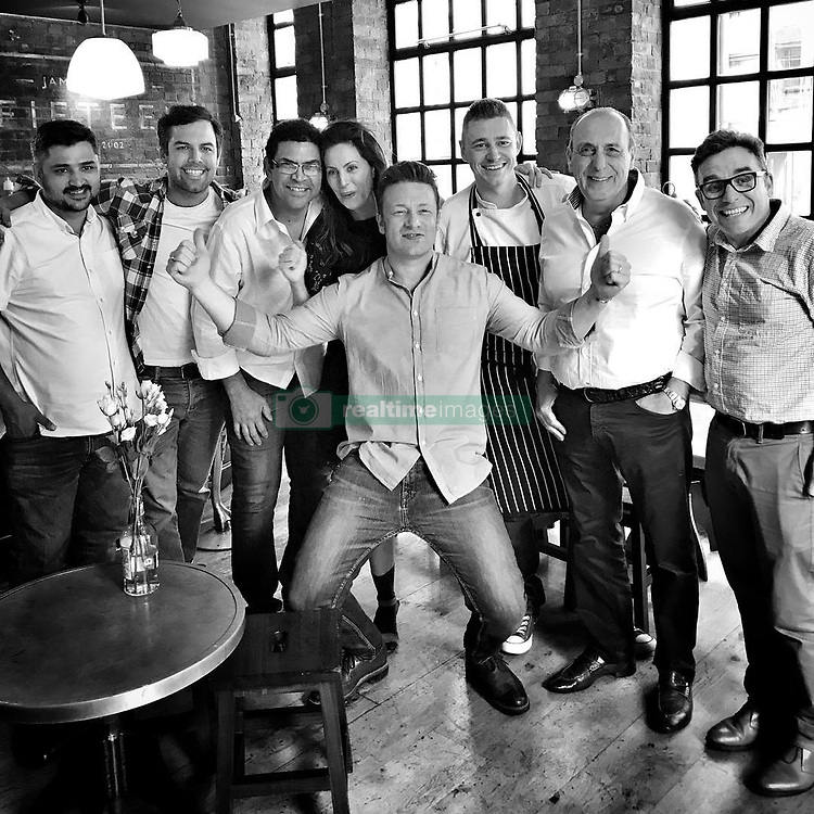 "Jamie Oliver releases a photo on Instagram with the following caption: ""Today we had a sweet lunch party for @jamiesfifteen being 15 years old at the end of #londonfoodmonth and some of our old wonderful graduates and friends came back to do a shift @timsiadatan @johnrelihan @deanmcclumpha @gennarocontaldo @dannymccubbin @elisa__roche and @santos.almir.7 big love guys what a joy to see them !!!jox x x x"". Photo Credit: Instagram *** No USA Distribution *** For Editorial Use Only *** Not to be Published in Books or Photo Books ***  Please note: Fees charged by the agency are for the agency's services only, and do not, nor are they intended to, convey to the user any ownership of Copyright or License in the material. The agency does not claim any ownership including but not limited to Copyright or License in the attached material. By publishing this material you expressly agree to indemnify and to hold the agency and its directors, shareholders and employees harmless from any loss, claims, damages, demands, expenses (including legal fees), or any causes of action or allegation against the agency arising out of or connected in any way with publication of the material."