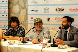 "July 4, 2017 - Naples, Italy - Former Argentinian football player Diego Armando Maradona (C), Italian actor Alessandro Siani (L) and Naples' municipal councillor for Sports Ciro Borriello (R) during a press conference at Villa D' Angelo to present the public event ""Effetto Maradona'' where he will get the honorary citizenship after thirty years from his presentation at San Paolo stadium in Naples, Italy on July 04, 2017. (Credit Image: © Paolo Manzo/NurPhoto via ZUMA Press)"