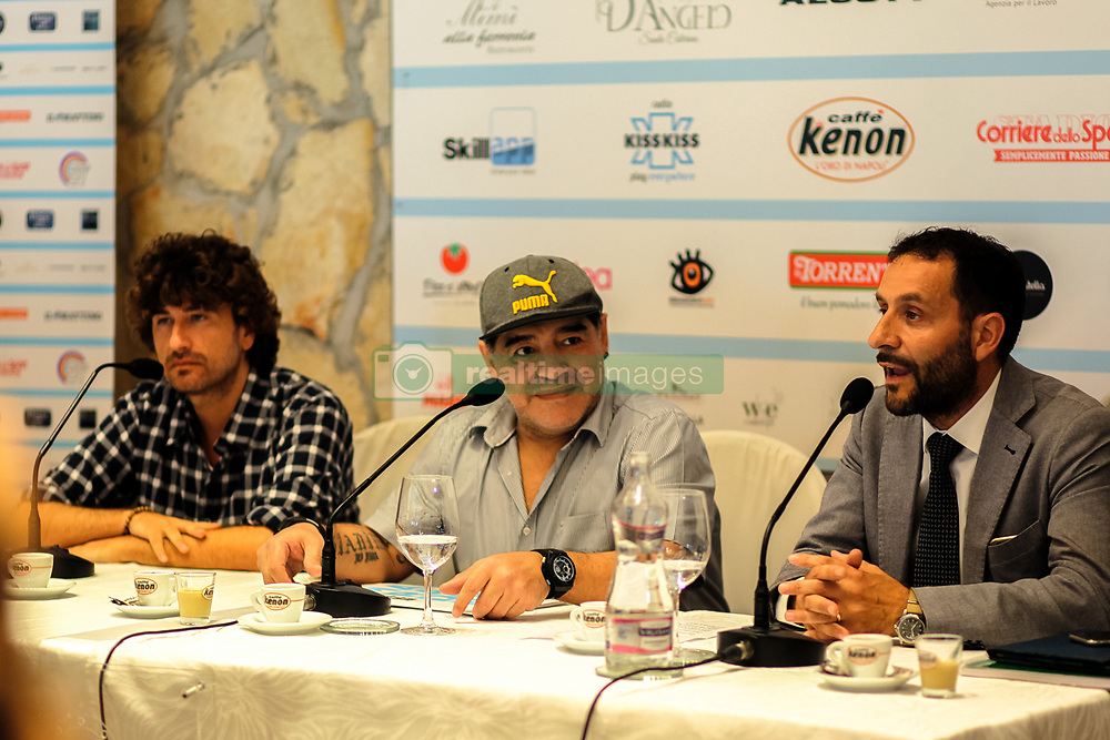 """July 4, 2017 - Naples, Italy - Former Argentinian football player Diego Armando Maradona (C), Italian actor Alessandro Siani (L) and Naples' municipal councillor for Sports Ciro Borriello (R) during a press conference at Villa D' Angelo to present the public event """"Effetto Maradona'' where he will get the honorary citizenship after thirty years from his presentation at San Paolo stadium in Naples, Italy on July 04, 2017. (Credit Image: © Paolo Manzo/NurPhoto via ZUMA Press)"""