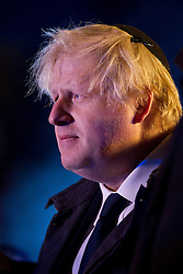 © Licensed to London News Pictures. 10/12/2012. London, UK. The Mayor of London, Boris Johnson, is seen wearing a Jewish kippa at the ceremony for the lighting of Britain's largest Hanukkah menorah in front of the National Gallery in Trafalgar Square this evening (10/12/12). The Menorah, lit as part of the Jewish Hanukkah celebration will be on display until the Sunday the 16th of December. Photo credit: Matt Cetti-Roberts/LNP
