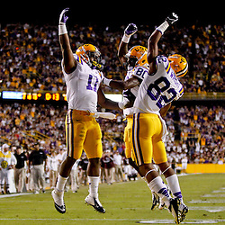 November 10, 2012; Baton Rouge, LA, USA; LSU Tigers running back Spencer Ware (11) celebrates with teammates wide receiver Jarvis Landry (80) and wide receiver James Wright (82) following a touchdown during the second quarter of a game at Tiger Stadium.  Mandatory Credit: Derick E. Hingle-US PRESSWIRE