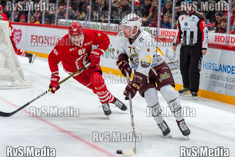 LAUSANNE, SWITZERLAND - NOVEMBER 23: #71 Tanner Richard of Geneve-Servette HC battles for the puck with #80 Robin Leone of Lausanne HC during the Swiss National League game between Lausanne HC and Geneve-Servette HC at Vaudoise Arena on November 23, 2019 in Lausanne, Switzerland. (Photo by Monika Majer/RvS.Media)