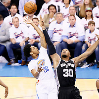 06 May 2016: Oklahoma City Thunder guard Cameron Payne (22) goes for the floater over San Antonio Spurs forward David West (30) during the San Antonio Spurs 100-96 victory over the Oklahoma City Thunder, during Game Three of the Western Conference Semifinals of the NBA Playoffs at the Chesapeake Energy Arena, Oklahoma City, Oklahoma, USA.