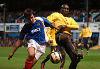 Photo: Ed Godden.<br />Portsmouth v Arsenal. The Barclays Premiership. 12/04/2006. Andy O'Brien (L) is challenged by Arsenal's Sol Campbell.