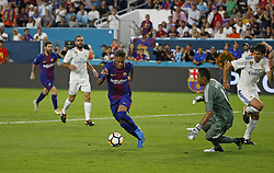 Barcelona forward Neymar, middle, attempt a shot against Real Madrid goalkeeper Keylor Navas, second from right, during the second half of the International Champions Cup match on Saturday, July 29, 2017, at Hard Rock Stadium in Miami Gardens, FL, USA. Barcelona won, 3-2. Photo by David Santiago/El Nuevo Herald/TNS/ABACAPRESS.COM