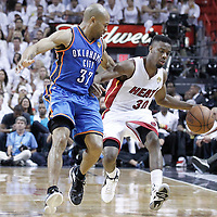 21 June 2012: Miami Heat point guard Norris Cole (30) brings the ball ucpourt under defensive pressure from Oklahoma City Thunder point guard Derek Fisher (37) during the Miami Heat 121-106 victory over the Oklahoma City Thunder, in Game 5 of the 2012 NBA Finals, at the AmericanAirlinesArena, Miami, Florida, USA. The Miami Heat wins the series 4-1.