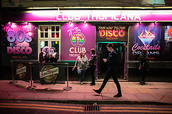 "© Licensed to London News Pictures . 27/10/2018. Manchester, UK. People outside Club Tropicana in Manchester City Centre's "" Gay Village "" . Revellers on a night out , many in fancy dress , on the weekend before Halloween . Photo credit: Joel Goodman/LNP"