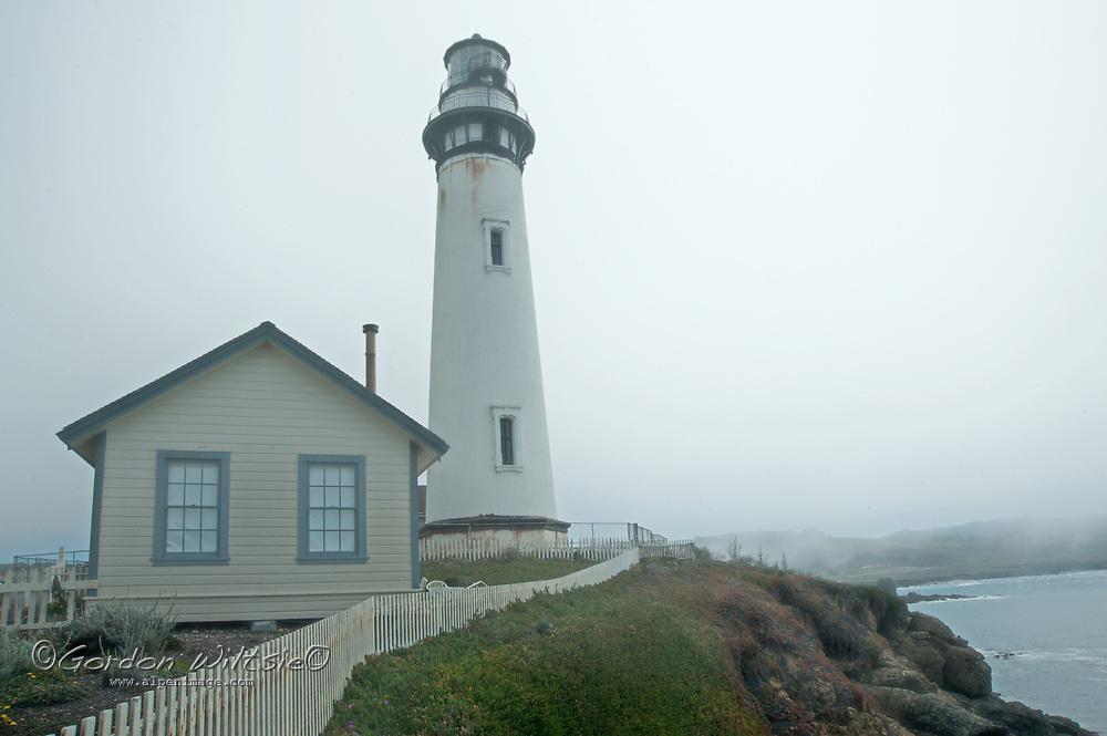 Fog enshrouds the Pigeon Point Lighthouse on the Pacific Ocean coast near Pescadero, California.