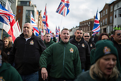 © Licensed to London News Pictures . 15/11/2014 . Kent , UK . Britain First leader PAUL GOLDING (in green sweater) at a march by Britain First on High Street Rochester during the final weekend before the Rochester and Strood by-election . Photo credit : Joel Goodman/LNP