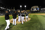 CHICAGO - SEPTEMBER 10:  Chris Sale #49 celebrates with Freddy Garcia #34 and other teammates of the Chicago White Sox after earning a save against the Kansas City Royals on September 10, 2010 at U.S. Cellular Field in Chicago, Illinois.  The White Sox defeated the Royals 4-3.  (Photo by Ron Vesely)