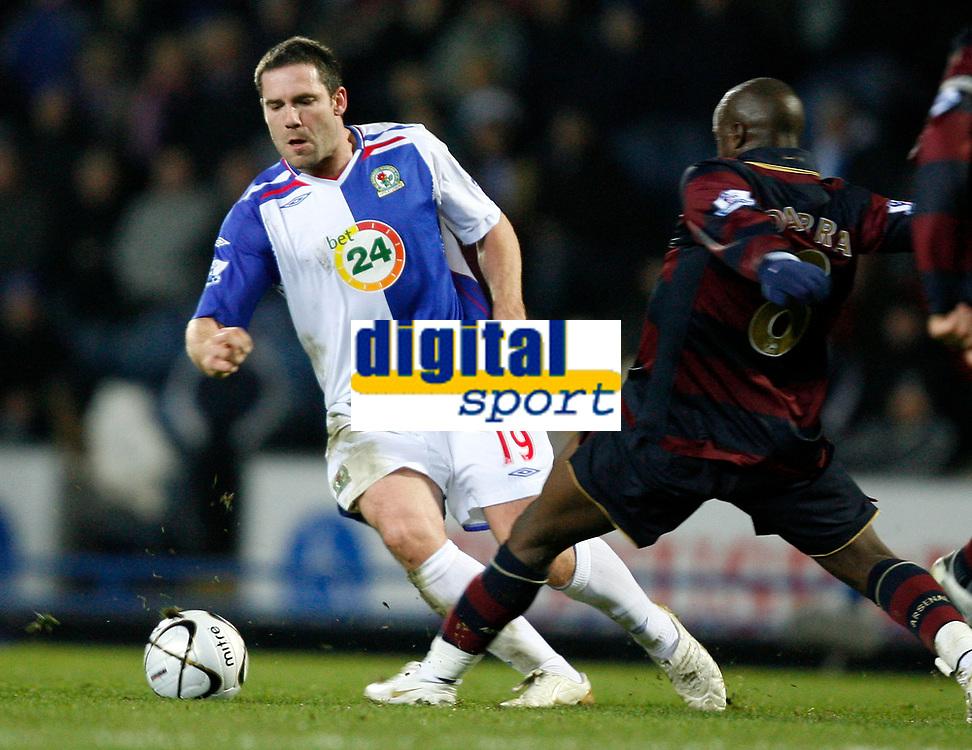 Photo: Paul Greenwood/Sportsbeat Images.<br />Blackburn Rovers v Arsenal. Carling Cup, Quarter Final. 18/12/2007.<br />Arsenal's Lassana Diarra (L) tackles Blackburn's David Dunn