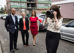© Licensed to London News Pictures. 20/07/2015. London, UK. Labour leadership contender Liz Kendall (right) takes photos of photographers alongside Chuka Umunna, Emma Reynolds and Gloria De Piero at Roupell Park Estate in Brixton after borrowing PA photographer Stefan Rousseau's camera. Photo credit : James Gourley/LNP