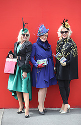 Racegoer Bernie Ladon-Bolger (left), Maria Stack (centre) and Dawn Ladon-Bolger during day two of the Punchestown Festival in Naas, Co. Kildare.