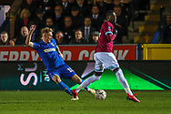 AFC Wimbledon midfielder Mitchell (Mitch) Pinnock (11) crossing the ball during the The FA Cup match between AFC Wimbledon and West Ham United at the Cherry Red Records Stadium, Kingston, England on 26 January 2019.