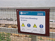Environment Agency sign, coastal defences, East Lane, Bawdsey, Suffolk, England
