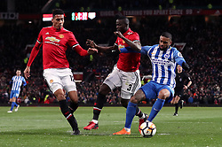 Brighton & Hove Albion's Jurgen Locadia battles for the ball with Manchester United's Chris Smalling (left) and Eric Bailly (centre) during the Emirates FA Cup, quarter final match at Old Trafford, Manchester.