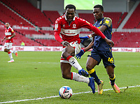 Middlesbrough's Marc Bola reacts after being fouled by Stoke City's Rabbi Matondo<br /> <br /> Photographer Alex Dodd/CameraSport<br /> <br /> The EFL Sky Bet Championship - Middlesbrough v Stoke City - Saturday 13th March 2021 - Riverside Stadium - Middlesbrough<br /> <br /> World Copyright © 2021 CameraSport. All rights reserved. 43 Linden Ave. Countesthorpe. Leicester. England. LE8 5PG - Tel: +44 (0) 116 277 4147 - admin@camerasport.com - www.camerasport.com