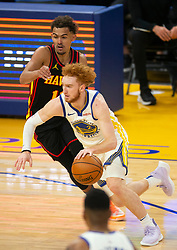 Mar 26, 2021; San Francisco, California, USA; Golden State Warriors guard Nico Mannion (2) drives past Atlanta Hawks guard Trae Young (11) during the first quarter of an NBA basketball game at Chase Center. Mandatory Credit: D. Ross Cameron-USA TODAY Sports