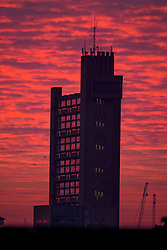© Licensed to London News Pictures. 12/02/2021. London, UK. A deep red sunrise behind the Trellick Tower in Notting Hill, West London, on another morning of sub zero temperatures in the capital. Photo credit: Ben Cawthra/LNP