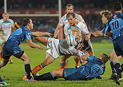PRETORIA, South Africa, 28 May 2011. Corne Uys of the Cheetahs is tackled by Dean Greyling of the Bulls during the Super15 Rugby match between the Bulls and the Cheetahs at Loftus Versfeld in Pretoria, South Africa on 28 May 2011..Photographer : Anton de Villiers / SPORTZPICS