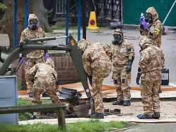 © Licensed to London News Pictures. 24/04/2018. Salisbury, UK. Members of the armed forces remove contaminated soil in the area at the Maltings where a bench was earlier removed as the cleanup operation begins in Salisbury. Former Russian Spy Sergei Skripal and his daughter Yulia were poisoned using a nerve agent in the city last month. Experts have warned that 'Toxic levels' of the nerve agent novichok could still be present at hot spots around the city. Photo credit: Peter Macdiarmid/LNP